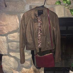 Brown jacket w/red purse!